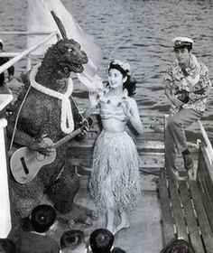 This is how Godzilla unwinds after a hard day destroying Tokyo.  Love this behind the scenes pic with the cast from original Japanese film.