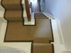 Sisal runner with cotton border fitted on stairs & half landing of an Exeter home.