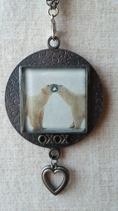 Polar bear bezel filled with fine glitter and topped with liquid resin.  Can be used as an ornament or necklace.  Want to see more?  https://www.etsy.com/shop/BezelsandBeyond