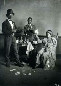 Magician and assistants.  1920's