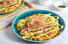Okonomiyaki is a Japanese pancake. This recipe is for the Osakastyle version which can be topped with a variety of ingredients.