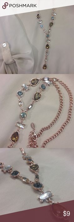 Rose Gold and Gem Express Necklace This is a uniquely shaped Express necklace with a beautiful rose gold finish and multi colored  blue-ish gray, olive green and clear/white gems. Express Jewelry Necklaces