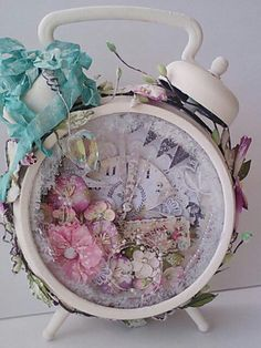 Pastel-colored altered clock. Love the light pinks, lavender and blues used.