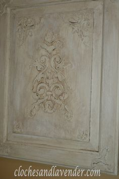 Cabinet door, stencil, plaster, paint, and glaze. Beautiful!