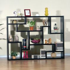 Black Bookcases Target On Dark Pergo Flooring With White Baseboard And Tall…