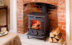 The AGA Little Wenlock Classic multi-fuel and wood burning stove is a compact cast iron stove which has been designed for cosy to medium sized living rooms and standard fireplace openings. Precision engineering and intelligent design make the Little We Aga Stove, Kitchen Stove, Best Wood Burning Stove, Stoves For Sale, Multi Fuel Stove, Cast Iron Stove, Stove Fireplace, Fireplace Ideas, Fireplace Inserts