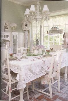 Vintage shabby chic dining room with lace tablecloth.