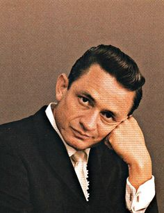 Johnny Cash. A little bored. Through the lens of Leigh Wiener.