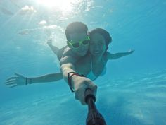 Kent Newgen and girlfriend keeping cool in the Riviera Maya, Mexico. Every GoPro camera comes with a waterproof housing, perfect for underwater vacation selfies! https://gopro.com/cameras