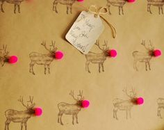 hand stamped reindeer with bright pom poms above here and tissue paper fun below