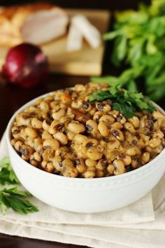 Honor Southern tradition by enjoying this New Year's Day Black Eyed Peas recipe, along with collards and pork.  It may just bring you luck and good fortune for the upcoming year!