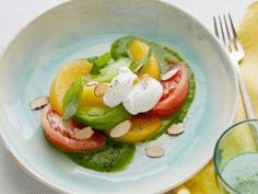 Tomato Peach Salad with Ricotta : This salad is best at the height of summer. The crunch of the almonds complements the creaminess of the ricotta cheese and the juiciness of the fruit.