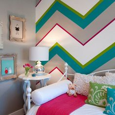 I hope we are allowed to paint as renters in our new home. I would love to do a colorful chevron wall like this for Emily's room