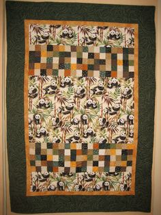 Panda Bear  baby quilt. I purchased the fabric in San Diego after seeing the pandas at the zoo.