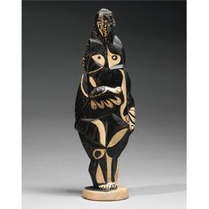 PABLO PICASSO & HENRI LAURENS = FEMME DEBOUT, Terracotta and India ink, 29.5 cm. Executed in terracotta by Laurens in 1921 and painted by Picasso between 1951-53.