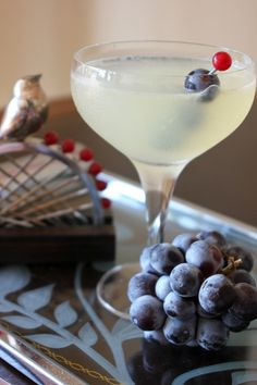 The Corpse Reviver Martini: Love Gin, Grapes and Lime? Try this perfectly portioned and tasty cocktail. 1 part Gin; 1 part Lillet; 1 part fresh lemon juice; 1 parts Triple Sec; Dash of Absinthe or Pastis. Also love the beautiful glassware in this photo. Sweet Cocktails, Winter Cocktails, Classic Cocktails, Champagne Cocktail, Cocktail Drinks, Cocktail Recipes, Drink Recipes, Cocktail Glass, Cocktail Shaker