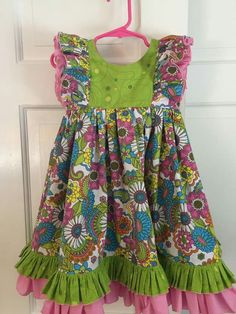 """Clara  by Suzanne Cronin from VFT pattern group on FB. Re ruffle sizes ~The pink was 4"""" and the green was 2.5. Cut three inches off the length of the skirt to accommodate the ruffles which are triple through width of the skirt bottom"""