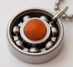 This pendant burns bright! Agate is said to enhance one's perceptiveness and to stimulate analytical capacity (both definitely needed in derby!), while also alleviating hostilities and promoting goodwill. And this orange fire agate is a burst of sunshine on a gloomy day; make it your lucky piece today!