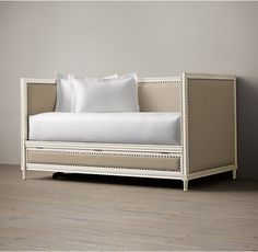 RH's Maison Daybed:Inspired by late-18th-century French furnishings, we've captured the linearity, rectangular shapes and painted finishes associated with that period. Upholstered in sand Belgian Linen and crafted of solid hardwood, each piece is carefully distressed with a white finish using a hand-applied 16-step process to achieve the look of a weathered antique. The tapered, slightly turned legs are fluted, a reference to Classic columns.