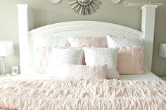 I really love this whole room. Especially the pouffy bed cover. And the palest pink, white and gray color scheme. Read about it here: http://www.decorchick.com/bedroom-makeover/
