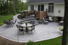 Enhance your home's exterior with a stamped concrete patio! designcastconcrete.com