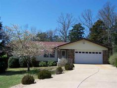 2 BR 2 BA, open living area, stone fireplace, whole house fan, 10 x 15 screened back porch and all city utilities in Mountain Home AR