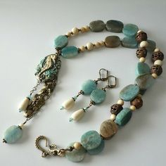 This new one of a kind necklace and earrings are made with beautiful quartz gemstones in perfect beach tones of aquas and browns, very