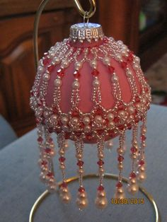 Here is the same in another color variation--how to attach a bracelet to a cover--Veiled beauty in indian pink & silver PK Beaded Christmas Decorations, Crochet Christmas Ornaments, Christmas Tree Ornaments, Beaded Ornament Covers, Beaded Ornaments, Beaded Jewelry Patterns, Beading Patterns, Ornaments Design, Beading Projects