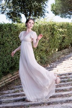 Simple wedding gown with cap sleeves. The empire waist can help small breasts appear larger.