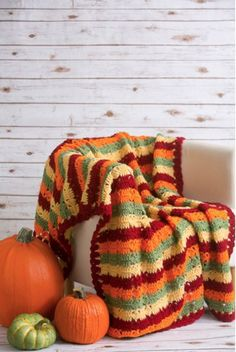 Autumn Fields Throw - Accessorize your couch or your bed with this bright and beautiful autumn throw. The Autumn Fields Throw is worked in rows in vivid fall hues and is sure to brighten up any room. From the October 2015 issue of I Like Crochet Thanksgiving Crochet, Crochet Fall, Holiday Crochet, Love Crochet, Crochet Afghans, Afghan Crochet Patterns, Crochet Stitches, Crochet Blankets, Crochet Squares
