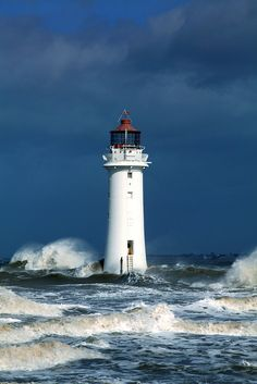 The Lighthouse in an Irish Sea Storm. Perch Rock Light offers a welcoming landmark in the approach to the Port of Liverpool