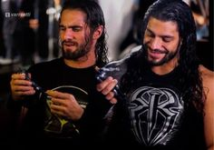 """Roman and """"baby brother"""" Seth Rollins taping the Mattel Make A WWE Superstar commercial"""