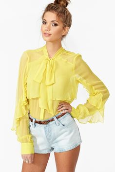 Sunburst Blouse -- Not with those shorts but perhaps a light colored pencil skirt :D