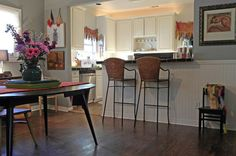 Idea for opening wall between kitchen and living room  eclectic dining room by Sarah Greenman