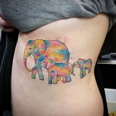 Little family of watercolour elephants ... thankyou chick  #tattoo #bodycraft #nottingham #elephanttattoo by electric_butterfly_tattooo