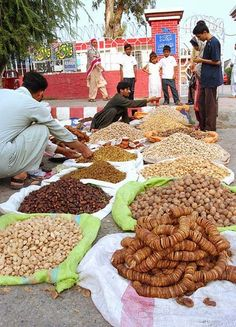 ISLAMABAD: October 27 – Vendors selling dry fruits to attract the customers at Sunday Bazaar in Federal Capital.