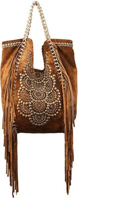 Fringed beauty. This reminds me of Ali McGraw, Raquel Welch and other beauties so popular in the 60's. Hippie chic at its best