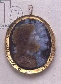 Cameo, bearing images of Serapis and Isis, in 16th century gold frame bearing the names of Marcus Antoninius and his wife Faustina (sardonyx) - Roman  c.2nd Century AD