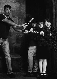 Daniel Radcliffe, Emma Watson and Rupert Grint on the set of Harry Potter and the Sorcerer's Stone.