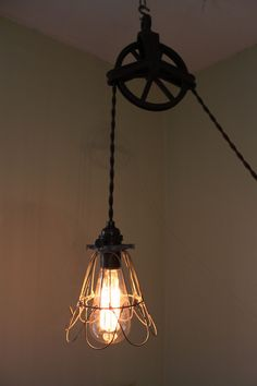 Antique Pulley Wheel Lamp with cage cover.