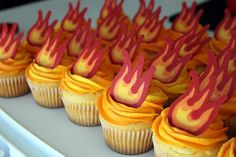 Party Frosting: Fireman/Firetruck Birthday Party Ideas & Inspiration - flame cupcakes using candy melts on wax paper Firefighter Cupcakes, Fireman Sam Cake, Fireman Sam Birthday Cake, Fireman Party, Firefighter Birthday, Fire Cupcakes, Fire Cake, Themed Cupcakes, Fire Fighter Cake