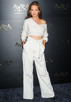 Katie Holmes in a cropped white sweater and high-waisted wide-leg white pants