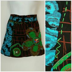 Urban Chic mini Skirt NWT Loaded with colors. Threaded, buttons, zipper, and charms details. So fun and playful. Tons of colors. Skirts