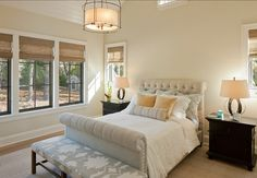 Shingle Style Family Home. Charming #GuestBedroom with neutral colors. Fond of upholstered headboard. Prefer silver /gray colored side chests.