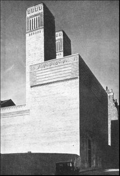 THE MERSEY TUNNEL - THE EXHAUST TOWERS of the six ventilating stations, three on either side of the river, range in height up to 210 feet. Each building contains duplicate sets of blower and exhaust fans which range up to 28 feet in diameter.