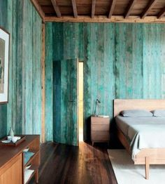 The home of Gu Qi, a furniture designer in Bejing, features a color-washed wall; via Daily Dream Decor