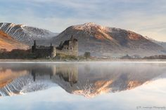Kilchurn Castle at sunrise on shores of Loch Awe