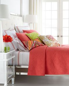 Fabulous tangerine colored bed linens by Trina Turk at Horchow, they work so well in an all white bedroom.
