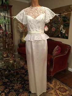 Tailored bodice with floral lace chest and ruffle trim. Pink satin with  white floral print material. Belts and other accessories are not included. 48f2d7a99