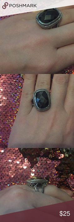 Black ring Black ring with lots of detailing on the sides. Size 7 Jewelry Rings